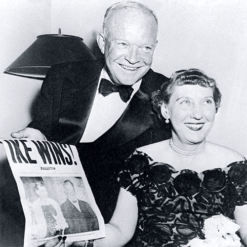 President Dwight D. Eisenhower and his wife, Mamie, hold up the front page of a newspaper in 1950 announcing his election victory. (Getty Images)
