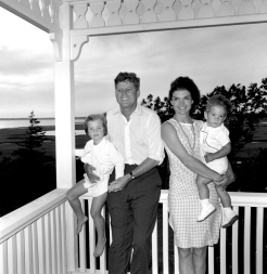 ST-22-1-62 04 August 1962 President Kennedy and family, Hyannis Port. L-R: Caroline Kennedy, President Kennedy, Mrs. Kennedy, John F. Kennedy, Jr. Photograph by Cecil Stoughton, White House, in the John F. Kennedy Presidential Library and Museum, Boston.